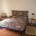 Ferienwohnung in Villa Mazzini - Schlafzimmer mit Doppel- und Einzelbett