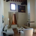Ferienwohnung Montepescali - Kaminecke im Wohnbereich