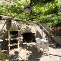 Versilia Ferienhaus Fabrizia - Barbecue-Bereich mit Essplatz im Garten