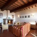 Ferienwohnung Portico - gemütliche Sitzecke am Kamin