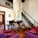Ferienwohnung La Querce - der Wohnraum mit Treppe zur Schlafgalerie