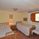 Ferienhaus Versiliana - Schlafzimmer Nr. 3 mit 3 Einzelbetten