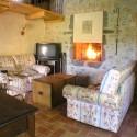 Ferienwohnung Santa Maria - Loggia - gemütliche Sitzecke am Kamin