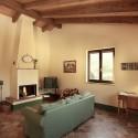 Ferienwohnung Cerro di Sopra - Wohnraum mit Kamin
