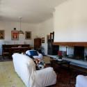 Villa Il Pescatore - gemütliche Sitzecke am Kamin