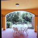 Ferienhaus Onda - überdachte Terrasse mit Blick ins Grüne